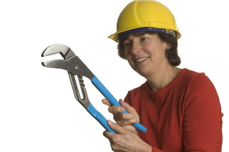 woman middle age: woman middle age with tools wearing safety helmet smiling home renovation