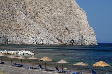 boys fishing on black sand perissa beach greek islands santorini Imagens