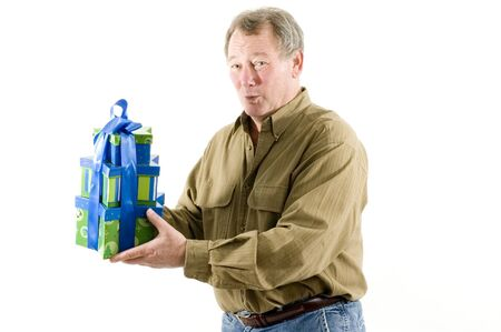 handsome man with gift wrapped presents smiling Stock Photo - 632501