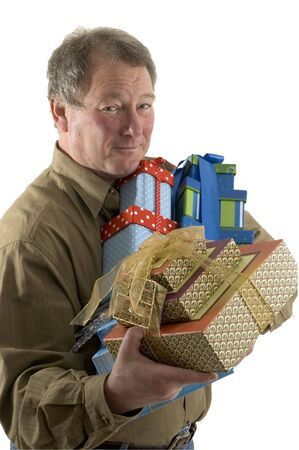 handsome man with gift wrapped presents smiling Stock Photo - 632498