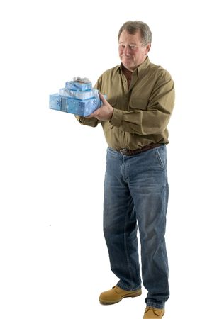 handsome man with gift wrapped presents smiling Stock Photo - 632484