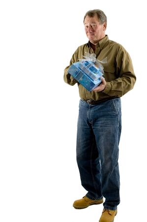 handsome man with gift wrapped presents smiling winking Stock Photo - 632485