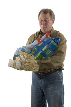handsome man with gift wrapped presents smiling winking Stock Photo - 632482