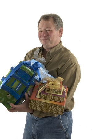 handsome man with gift wrapped presents smiling Stock Photo - 632477