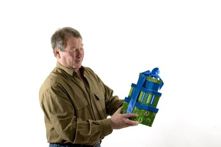 smiling man with gifts wrapped in boxes Stock Photo - 636463