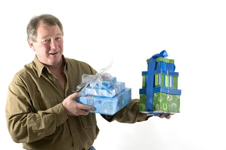 smiling man with gifts wrapped in boxes Stock Photo - 636464