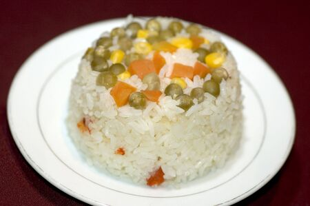 typical: rice carrots peas corn nicaragua typical Stock Photo