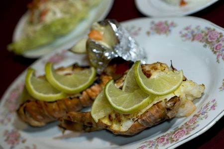 caribbean lobster tail with rice vegetables potato baked Stock Photo - 643061