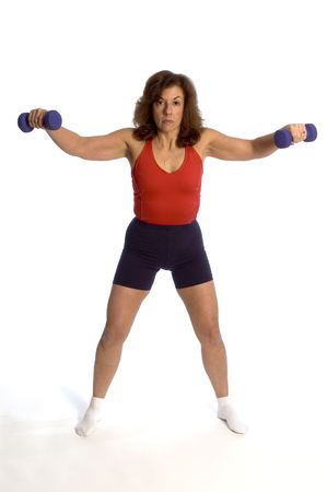 fitness trainer exercising with dumbells squat movement photo
