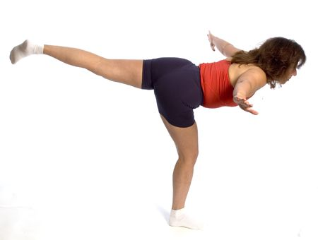 flying yoga position on one leg trainer fitness gym photo