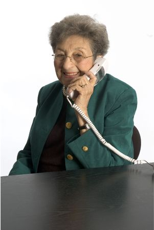 telephone saleswoman: attractive senior woman business executive talkiing on phone happy smiling
