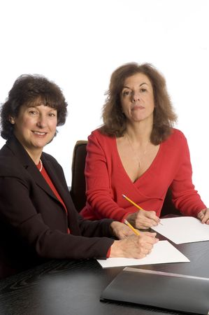old desk: two corporate partners middle aged women in office