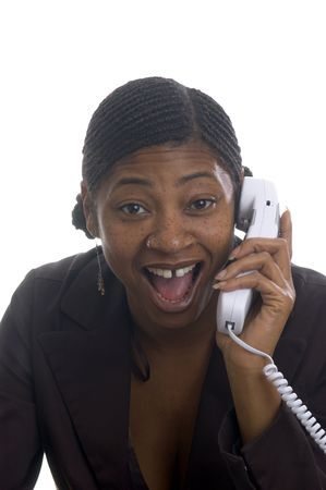 beautiful black woman customer service on telephone with surprised expression photo