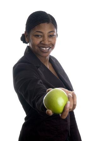 cornrows: hermosa mujer negro con fruta fresca verde manzana granny smith  Foto de archivo