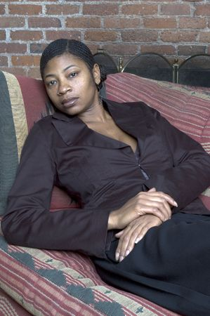 nosering: beautiful black woman on sofa relaxing sexy Stock Photo