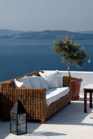 greek island scenic view from patio with sofa santorini Stock Photo