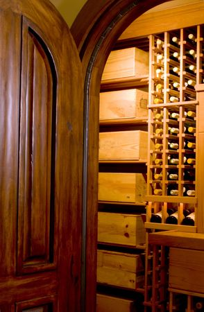 custom built mahogany door entry to wine cellar private mansion house residence Stock Photo - 682429