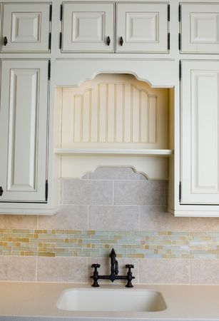 kitchen remodelling: detail custom tile work kitchen faucet wall hot cold control handles