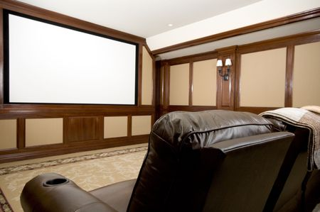 home theatre: home theatre in a mansion with custom woodwork plush seats Stock Photo