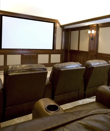 theater seat: home theatre in a mansion with custom woodwork plush seats Stock Photo