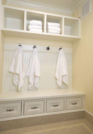 bathrobes towels hanging in a custom locker room photo