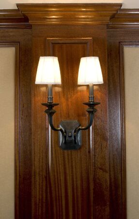 sconce: custom woodwork with two lights, in private residence mansion Stock Photo