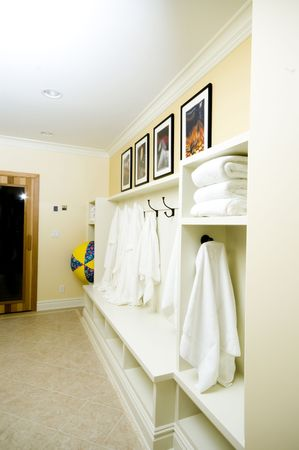 bathrobes towels hanging in a custom locker room with sauna entry photo
