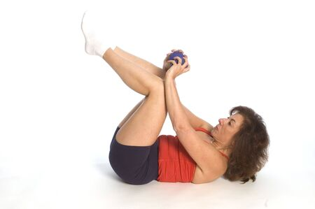 woman exercising sit ups with dumbells fitness instructor photo