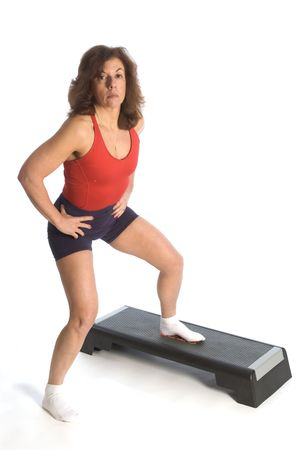 woman exercising on step unit fitness instructor photo