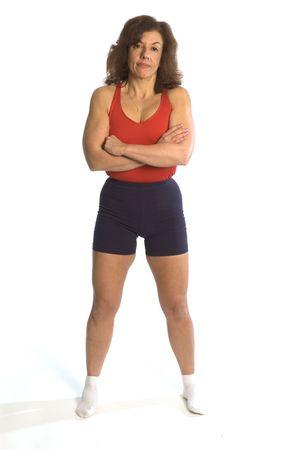 女性フィットネス インストラクター魅力的な中年を物理的に運動フィット笑みを浮かべて 写真素材