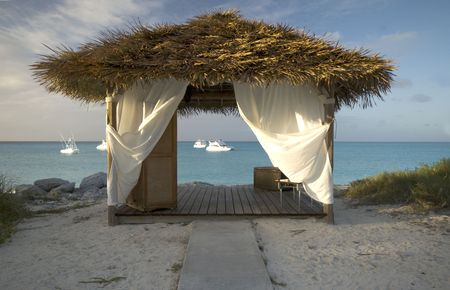 thatched roof: outdoor massage spa hut by the beautiful ocean sea Bahamas