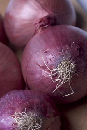 thin bulb: red onions macro view group on wood cutting board Stock Photo