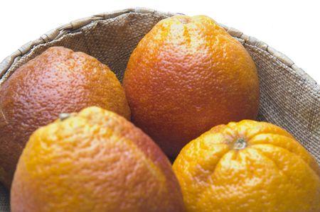 blood oranges citrus fruit in wicker basket group fresh