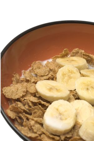breakfast cereal with bananas and milk wheat rice flakes slices