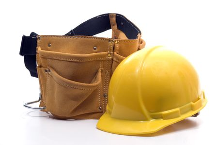 hard hat protection helmet and tool belt heavy duty suede leather work apron with pockets Stock Photo