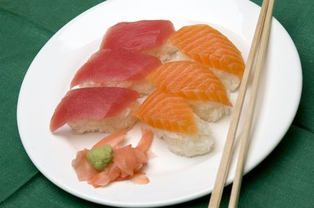 sushi variety food raw salmon tuna snapper japanese with wasabi horseradish ginger and chop sticks photo