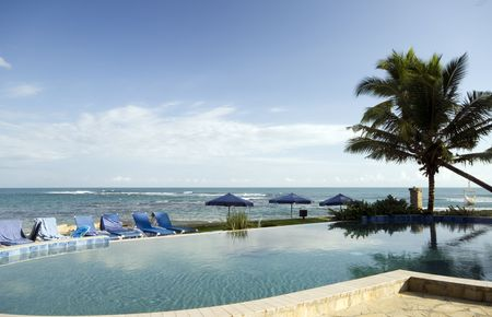 infinity swimming pool by the sea hotel resort  photo