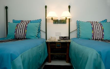 double beds: luxury resort hotel room with double beds and night table