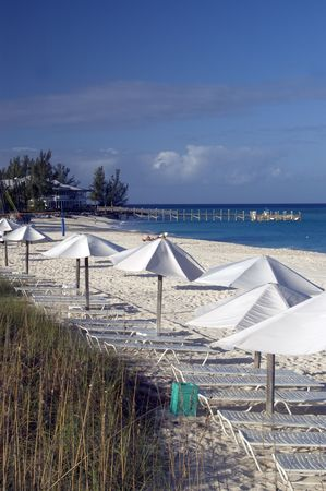 resort beach with umbrellas and lounge chairs photo