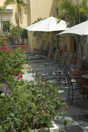 lounge chairs on patio of old hotel old san juan, puerto rico photo