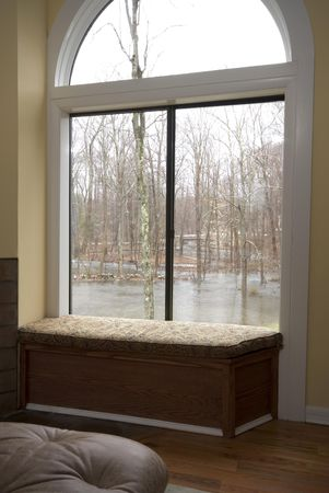 overrun: view of storm flood property from inside contemporary house living room Stock Photo