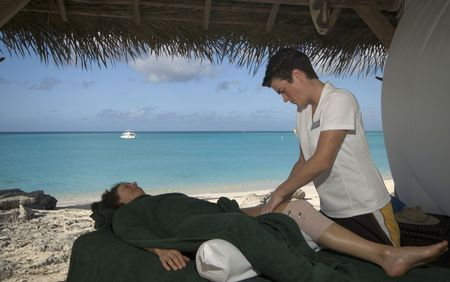 middle ages boat: woman relaxing with professional massage at resort by the sea