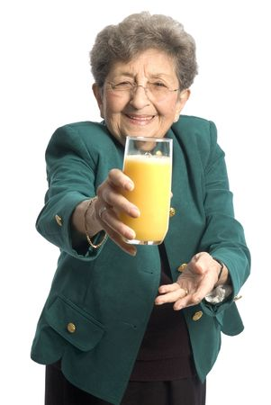 oj: attractive senior woman offering holding glass of fresh orange juice