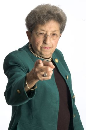 angry woman: serious senior female executive pointing finger Stock Photo