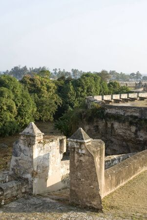 gates to fortalezza ozama prison military complex santo domingo dominican republic overlooking river ozama and caribbean sea cannons tower of homage photo