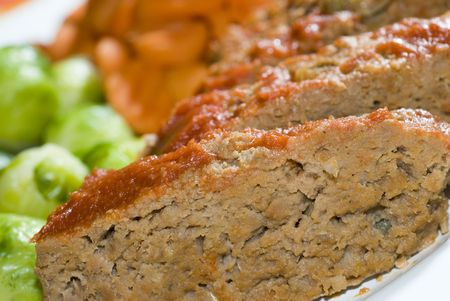 meat loaf: meat loaf brussels sprouts and carrots dinner plate Stock Photo