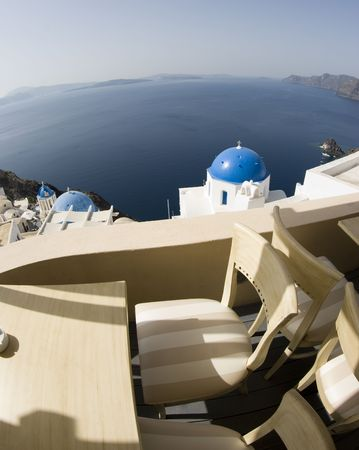 santorini restaurant cafe patio dining view classic church blue domes incredible greek islands photo