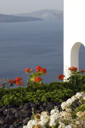 incredible: santorini incredible view over the caldera with flowers and classic house greek islands Stock Photo