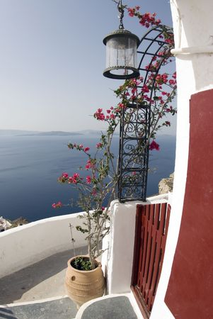 ove: greek island view ove the sea santorini oia with flowers Stock Photo