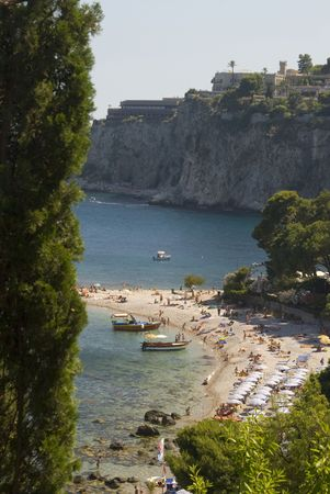 sicliy italy beach cove taormina with luxury hotel on hill mediterannean sea photo